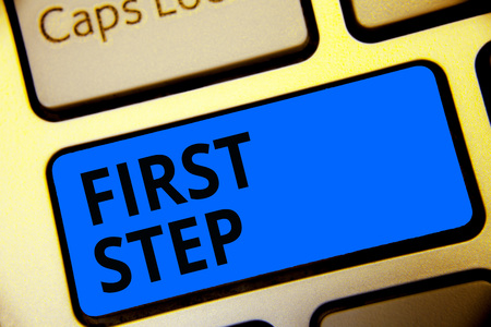 Writing note showing First Step. Business photo showcasing Pertaining to the start of a certain process or beginning Keyboard blue key Intention computer computing reflection document Stock Photo