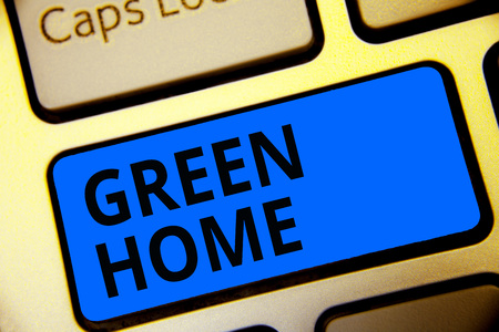 Writing note showing Green Home. Business photo showcasing An area filled with plants and trees where you can relax Keyboard blue key Intention computer computing reflection document