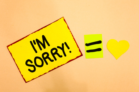 Conceptual hand writing showing I am Sorry. Business photo text To ask for forgiveness to someone you unintensionaly hurt Yellow paper reminder equal sign heart sending romantic feelings Stock fotó