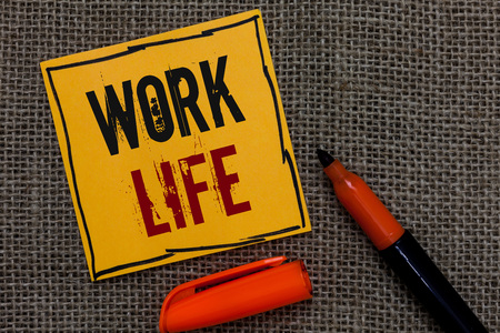 Conceptual hand writing showing Work Life. Business photo showcasing An everyday task to ern money to sustain needs of one's self Orange paper Marker Communicate ideas Jute background