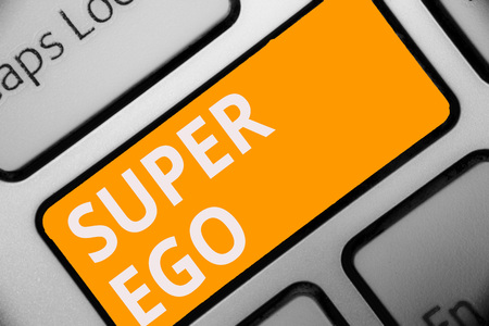 Writing note showing Super Ego. Business photo showcasing The I or self of any person that is empowering his whole soul Keyboard orange key Intention computer computing reflection document