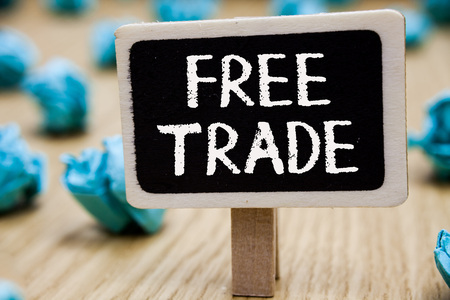 Text sign showing Free Trade. Conceptual photo The ability to buy and sell on your own terms and means Blackboard crumpled papers several tries mistake not satisfied wooden floor