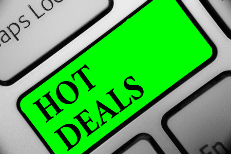 Handwriting text Hot Deals. Concept meaning An agreement through which one of the paties is offered and accept Keyboard green key Intention create computer computing reflection document Stok Fotoğraf