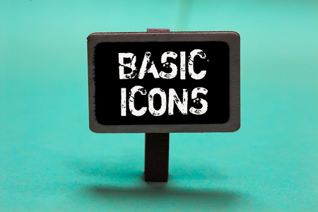 Text sign showing Basic Icons. Conceptual photo pictogram or ideogram displayed on a computer screen or phone Blackboard green background important message ideas communicate reflections Stock Photo