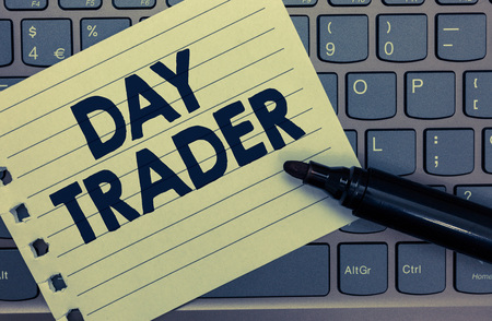 Conceptual hand writing showing Day Trader. Business photo showcasing A person that buy and sell financial instrument within the day Notebook paper keyboard Inspiration computer black marker Stockfoto