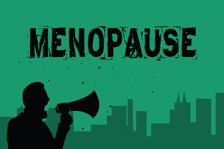 Word writing text Menopause. Business concept for Period of permanent cessation or end of menstruation cycle Man holding megaphone speaking politician making promises green background Stock Photo