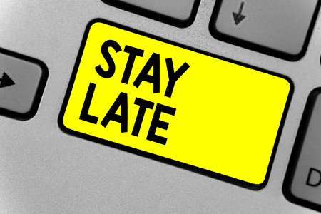 Writing note showing Stay Late. Business photo showcasing A routine in which a person goes to somewhere out of time Keyboard yellow key Intention computer computing reflection document Stock Photo