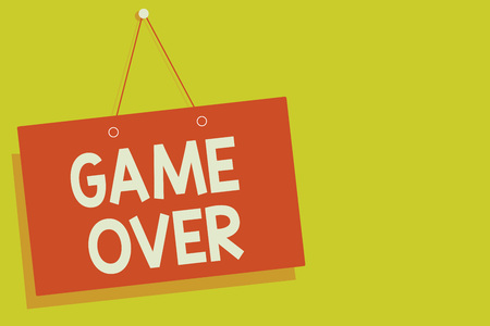 Handwriting text Game Over. Concept meaning A situation in a particular sport that reach his finals or ending Red board wall message communication open close sign yellow background Stock Photo