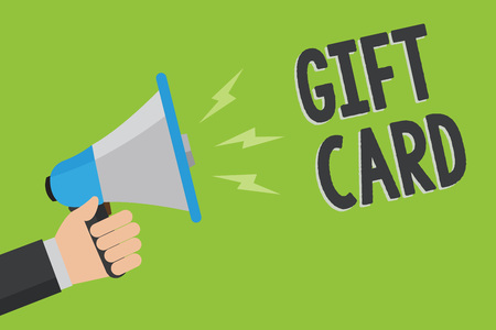 Writing note showing Gift Card. Business photo showcasing A present usually made of paper that contains your message Man holding megaphone loudspeaker green background message speaking