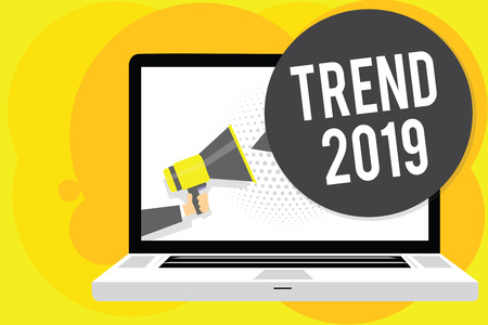 Conceptual hand writing showing Trend 2019. Business photo showcasing things that is famous for short period of time in current year Man holding Megaphone computer screen talking speech bubble 스톡 콘텐츠