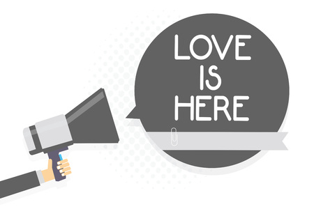 Word writing text Love Is Here. Business concept for Romantic feeling Lovely emotion Positive Expression Care Joy Man holding megaphone loudspeaker gray speech bubble white background