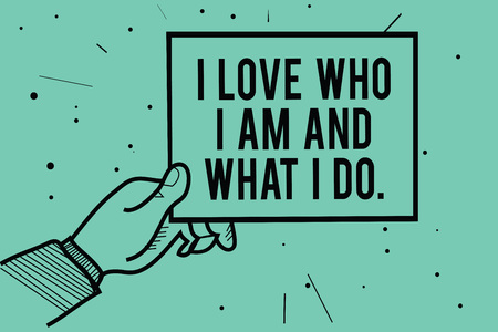 Text sign showing I Love Who I Am And What I Do.. Conceptual photo High self-stem being comfortable with your job Man hand holding paper communicating information dots turquoise background Imagens
