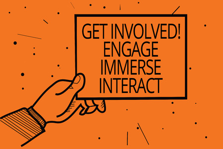 Writing note showing Get Involved Engage Immerse Interact. Business photo showcasing Join Connect Participate in the project Man hand holding paper communicating information dot orange background