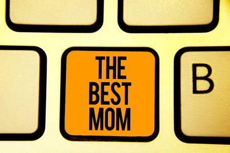 Text sign showing The Best Mom. Conceptual photo Appreciation for your mother love feelings compliment Keyboard orange key Intention create computer computing reflection document