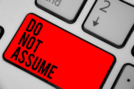 Conceptual hand writing showing Do Not Assume. Business photo text Ask first to avoid misunderstandings confusion problems Keyboard red key create computer computing reflection document