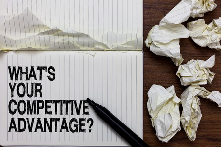 Handwriting text writing What s is Your Competitive Advantage question. Concept meaning Marketing strategy Plan Marker over notebook crumpled papers ripped pages several tries mistakes