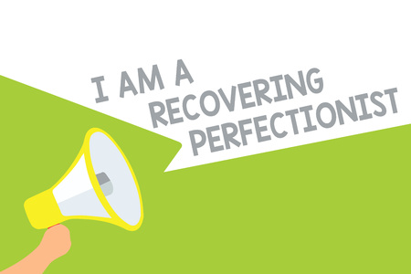 Text sign showing I Am A Recovering Perfectionist. Conceptual photo Obsessive compulsive disorder recovery Megaphone loudspeaker speech bubbles important message speaking out loud