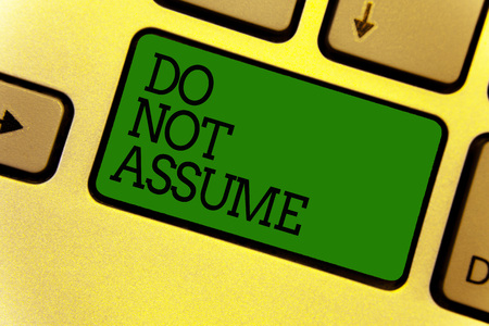 Conceptual hand writing showing Do Not Assume. Business photo text Ask first to avoid misunderstandings confusion problems Keyboard green create computer computing reflection document Foto de archivo
