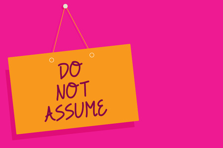 Word writing text Do Not Assume. Business concept for Ask first to avoid misunderstandings confusion problems Orange board wall message communication open close sign pink background
