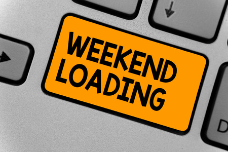 Word writing text Weekend Loading. Business concept for Starting Friday party relax happy time resting Vacations Keyboard orange key Intention create computer computing reflection document Фото со стока