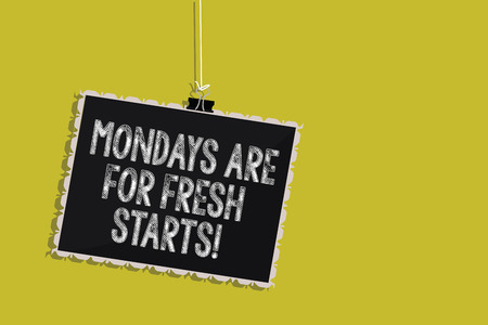 Handwriting text Mondays Are For Fresh Starts. Concept meaning Begin again every week have a good morning Hanging blackboard message communication information sign yellow background Banque d'images