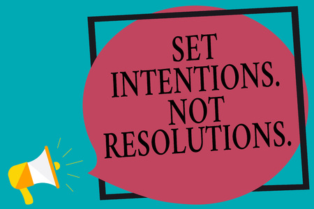 Handwriting text writing Set Intentions. Not Resolutions.. Concept meaning Positive choices for new start achieve goals Megaphone loudspeaker screaming turquoise background frame speech bubble Stock Photo