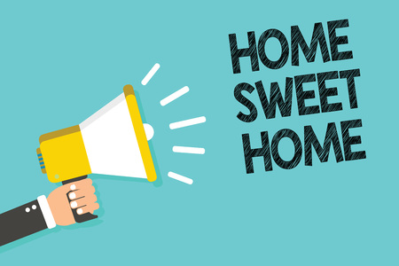 Writing note showing Home Sweet Home. Business photo showcasing In house finally Comfortable feeling Relaxed Family time Man holding megaphone loudspeaker blue background message speaking