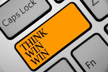 Conceptual hand writing showing Think Win Win. Business photo showcasing Business Strategy Competition Challenge Way to be success Keyboard orange key computer computing reflection document