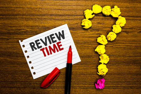 Handwriting text Review Time. Concept meaning situation or system its formal examination by people authority Paper marker crumpled papers forming question mark wooden background