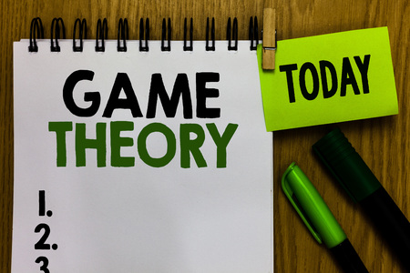 Text sign showing Game Theory. Conceptual photo branch of mathematics concerned with analysis of strategies Notebook clothespin holding reminder markers expressing ideas wood table Stok Fotoğraf