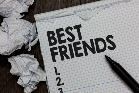 Text sign showing Best Friends. Conceptual photo A person you value above other persons Forever buddies Marker over notebook crumpled papers ripped pages several tries mistakes