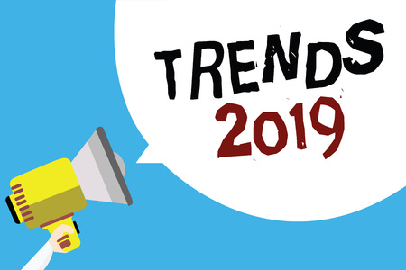 Writing note showing Trends 2019. Business photo showcasing Upcoming year prevailing tendency Widely Discussed Online Man holding megaphone loudspeaker speech bubble with blue background