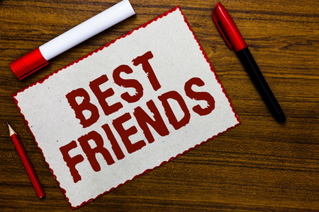 Handwriting text writing Best Friends. Concept meaning A person you value above other persons Forever buddies White paper red borders markers wooden background communicating ideas