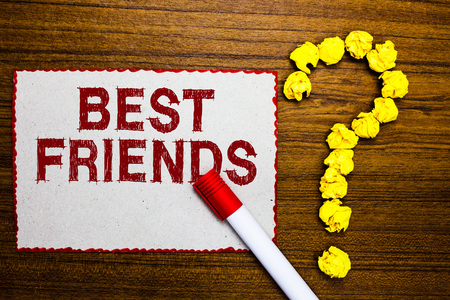 Text sign showing Best Friends. Conceptual photo A person you value above other persons Forever buddies White paper marker crumpled papers forming question mark wooden background Stock Photo