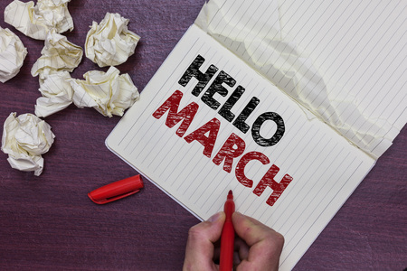 Handwriting text Hello March. Concept meaning musical composition usually in duple or quadruple with beat Man holding marker notebook page crumpled papers several tries mistakes Banco de Imagens