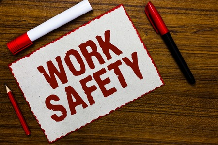 Handwriting text writing Work Safety. Concept meaning Policies and control in place according to government standard White paper red borders markers wooden background communicating ideas Stock Photo
