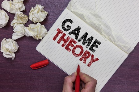 Handwriting text Game Theory. Concept meaning branch of mathematics concerned with analysis of strategies Man holding marker notebook page crumpled papers several tries mistakes