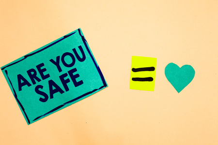 Text sign showing Are You Safe. Conceptual photo Free from danger Not anticipating any Harm Hurt physically Turquoise piece paper reminder equal sign heart sending romantic feelings Reklamní fotografie