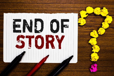 Handwriting text writing End Of Story. Concept meaning Emphasize that nothing to add Literature writing Journalism Paper markers crumpled papers forming question mark wooden background