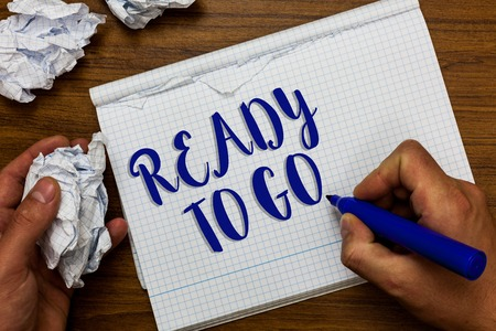 Conceptual hand writing showing Ready To Go. Business photo showcasing asking someone if he is prepared or packed his things Man holding marker notebook crumpled papers ripped pages