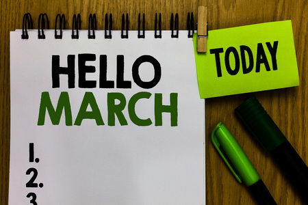 Text sign showing Hello March. Conceptual photo musical composition usually in duple or quadruple with beat Notebook clothespin holding reminder markers expressing ideas wood table Banco de Imagens