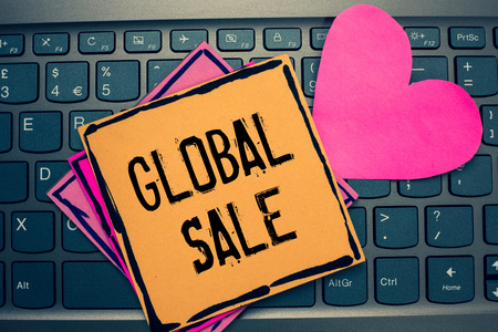 Writing note showing Global Sale. Business photo showcasing managers operations for companies do business internationally Papers Romantic lovely message Heart Keyboard computer Good feelings