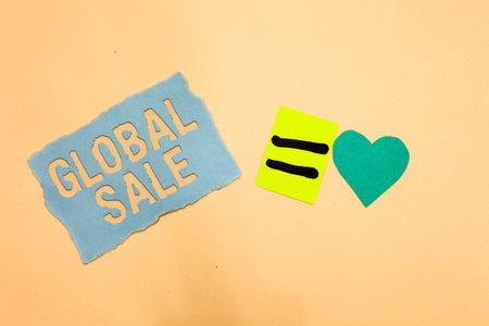 Writing note showing Global Sale. Business photo showcasing managers operations for companies do business internationally Blue paper reminder turquoise heart sending romantic ideas Reklamní fotografie