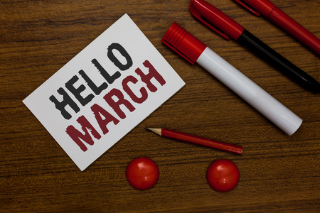 Writing note showing Hello March. Business photo showcasing musical composition usually in duple or quadruple with beat White paper markers wooden background communicating ideas messages Banco de Imagens
