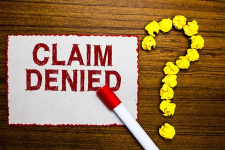 Text sign showing Claim Denied. Conceptual photo Requested reimbursement payment for bill has been refused White paper marker crumpled papers forming question mark wooden background