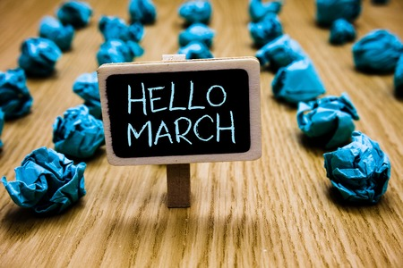 Word writing text Hello March. Business concept for musical composition usually in duple or quadruple with beat Blackboard crumpled papers several tries mistake not satisfied wooden floor