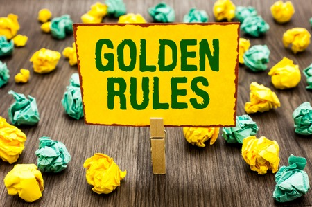 Conceptual hand writing showing Golden Rules. Business photo text Basic principle that should be followed Important Principle Clothespin holding yellow note paper crumpled papers mistakes