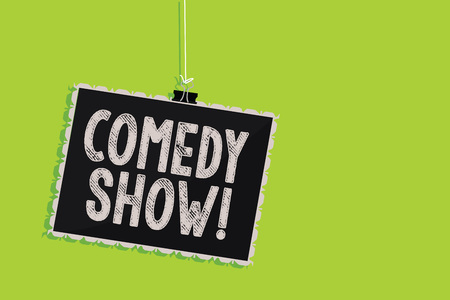 Conceptual hand writing showing Comedy Show. Business photo text Funny program Humorous Amusing medium of Entertainment Hanging blackboard message communication sign green background Reklamní fotografie