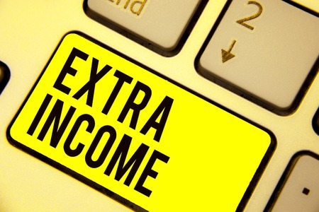 Word writing text Extra Income. Business concept for Additional fund received or earned from a non regular basis Keyboard yellow key Intention create computer computing reflection document