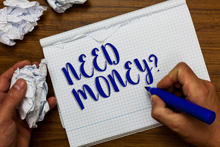 Conceptual hand writing showing Need Money question. Business photo showcasing asking someone if he needs cash or bouns Get loan Man holding marker notebook crumpled papers ripped pages Reklamní fotografie